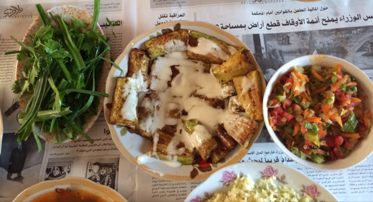 Grilled aubergine, salad, herbs and dips. Kirkuk home cooking, Iraq